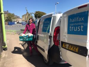 Community Organiser, Alison, loads our van with food deliveries during lockdown.